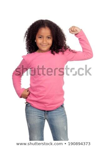 Cute girl showing biceps Stock photo © wavebreak_media