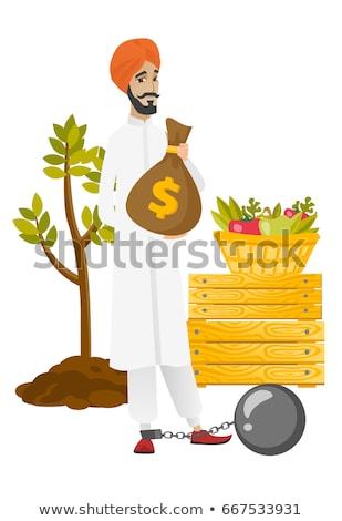 Hindu farmer holding a money bag. Stock photo © RAStudio