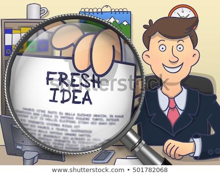 fresh idea through magnifying glass doodle style stock photo © tashatuvango