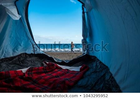nő · ül · tengerpart · ágy · néz · tenger - stock fotó © kzenon