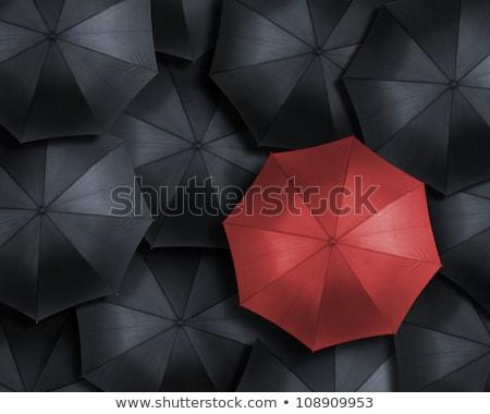 Top uniek Rood paraplu permanente Stockfoto © ISerg
