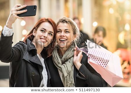 красивой · женщины · торговых · улице · глядя · магазине - Сток-фото © dolgachov