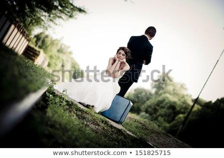 Husband in suitcase. Woman traveler Stock photo © rogistok