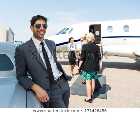 Woman and man leaning against a limo car Stock photo © Kzenon