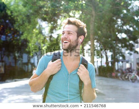 Férfi hátizsák fülhallgató város utazás turizmus Stock fotó © dolgachov