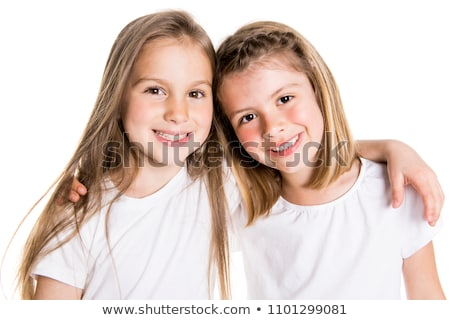 Portrait of two cute friends 7 years old girl Isolated over white background Stock photo © Lopolo