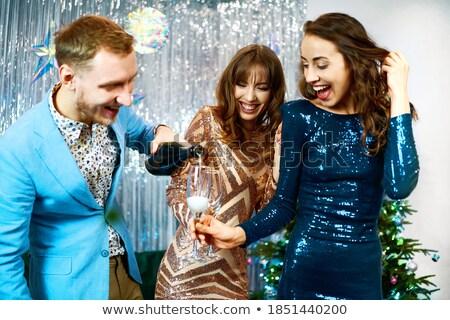 group of joyful smart dressed friends stock photo © deandrobot