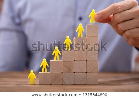 Yellow Human Figures Leading On Top Of Wooden Blocks Stock photo © AndreyPopov