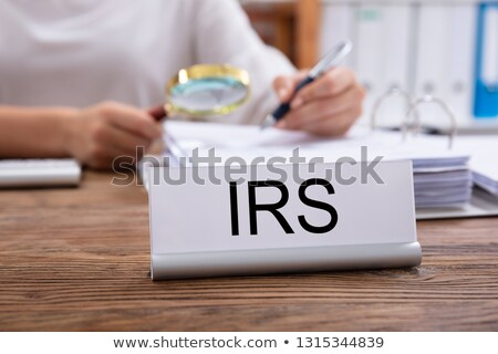 Nameplate With IRS Title Kept On Businesswoman's Desk Stock photo © AndreyPopov