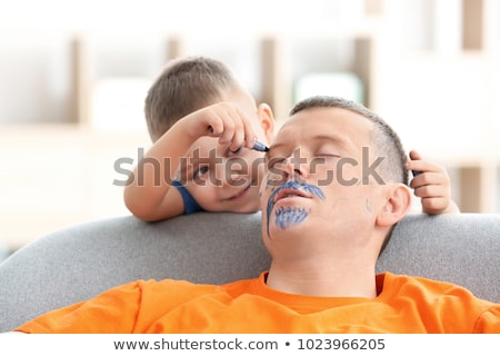 Child Painting Father's Face While He Is Sleeping Stock photo © AndreyPopov