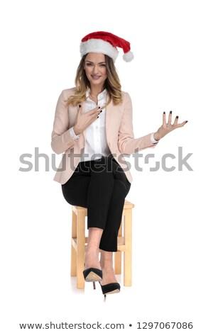 young blonde businesswoman wearing santa hat seating Stock photo © feedough