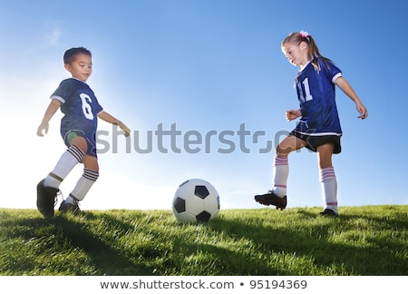 Two Young boy with soccer ball on a sport uniform Stock photo © Lopolo