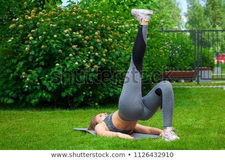 Sport and Exercise, Woman on Rug Lifting Legs Stock photo © robuart