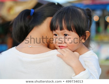Happy mother hugged with love by daugther Stock photo © ElenaBatkova
