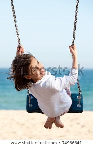 Little Girl Swinging On The Beach Stock photo © AndreyPopov