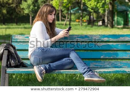 Güzel genç kadın öğrenci rahatlatıcı bank açık havada Stok fotoğraf © Giulio_Fornasar
