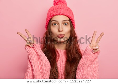 Young beautiful brunette woman  wearing knitted sweater reading  Stock photo © dashapetrenko