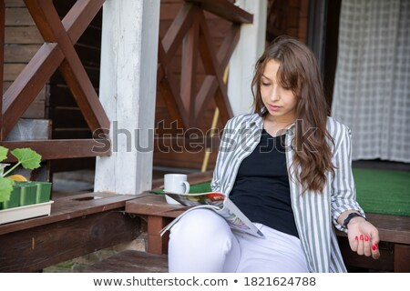 Fiatal csinos nő olvas magazin erkély jóreggelt Stock fotó © dashapetrenko