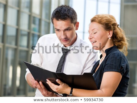 Confident businessman showing his business partner where to sign contract Stock photo © pressmaster