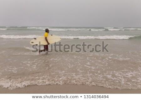 вид сбоку старший мужчины Surfer доска для серфинга работает Сток-фото © wavebreak_media