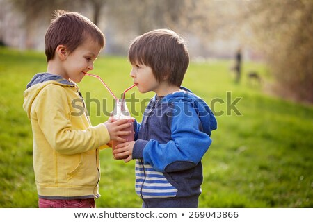 boy holding a banana smoothie stock photo © galitskaya