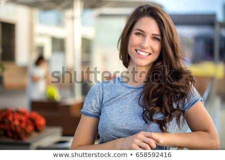 Young attractive woman smiles brightly  Stock photo © Lopolo