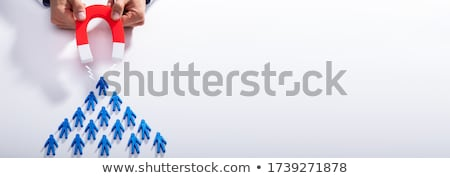 Businessman Attracting Blue Team With Horseshoe Magnet Stock photo © AndreyPopov