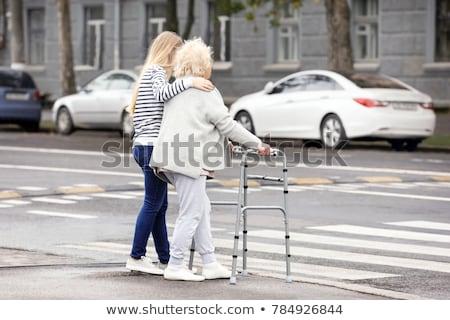 Grandmother crosses street road Stock photo © jossdiim