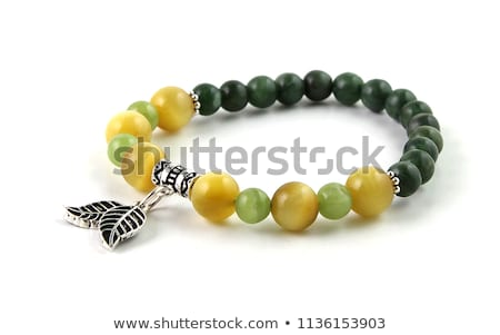 dark green gemstone isolated on white stock photo © oneo