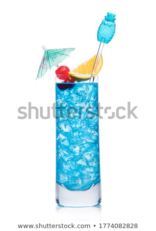 Blue lagoon cocktail highball glass with stirrer and orange slice with sweet cherry and umbrella on  Stock photo © DenisMArt
