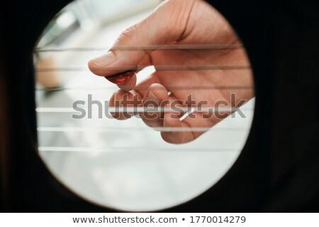 Strony człowiek gry wewnątrz otwór Zdjęcia stock © diego_cervo