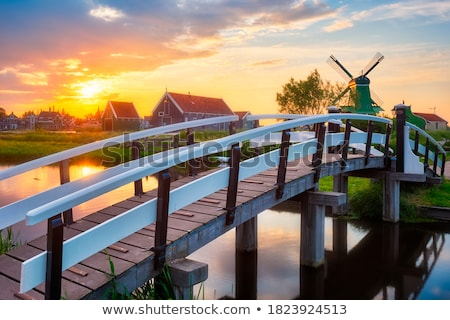 Bridge over canal at windmills at Zaanse Schans in Holland. Zaandam, Netherlands Stock photo © dmitry_rukhlenko