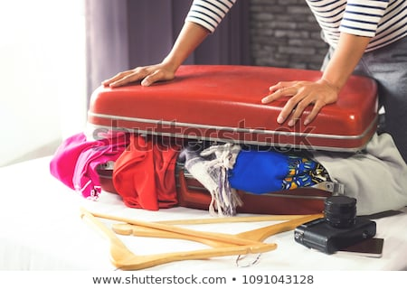 Travel And Vacation Concept Happiness Young Woman Packing A Lot Сток-фото © Freedomz