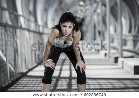 Tired woman runner exhausted breathing Stock photo © Maridav