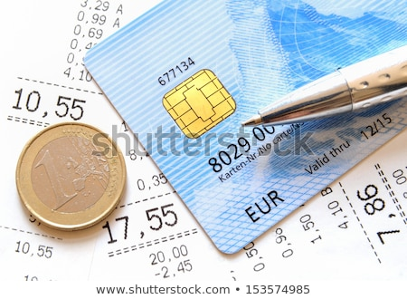 receipt with euro coins and ball pen stock photo © gewoldi
