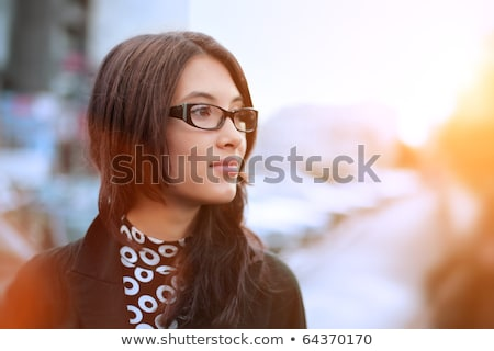 Portrait of a beautiful young businesswoman outside. Stock photo © HASLOO