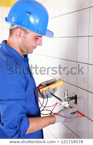 plumber checking wiring with a voltmeter stock photo © photography33
