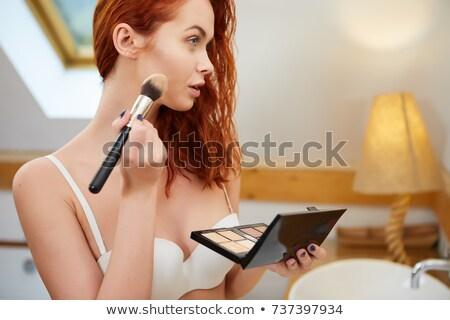 Applying Blusher To Cheekbone Stock photo © stryjek