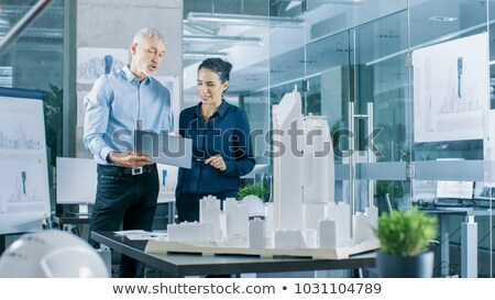 Woman with scale model of housing Stock photo © photography33
