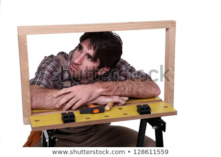 cabinet maker examining wooden frame stock photo © photography33