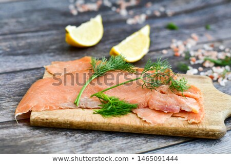 fresh red fish fillet on wooden plate stock photo © ozaiachin