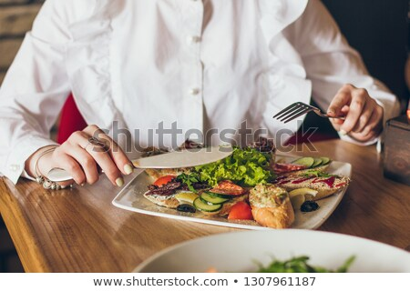 Tomato and salad canape on a fork stock photo © calvste