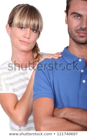 An unsure woman touching her husband's shoulder Stock photo © photography33