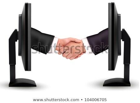 üzletemberek kézfogás ki tv képernyő számítógép Stock fotó © ozaiachin