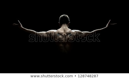 Strong arm of an athlete, isolated on black background Stock photo © Nobilior