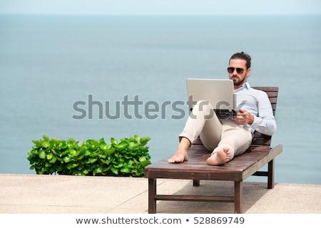 若い男 · ラップトップを使用して · ビーチ · 座って · セクシー · 幸せ - ストックフォト © victoria_andreas