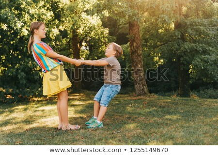 Girls holding hands around sun Stock photo © mintymilk