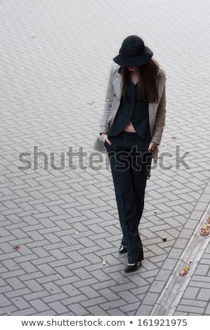 Sevimli genç kadın kat siyah tozluk Stok fotoğraf © acidgrey