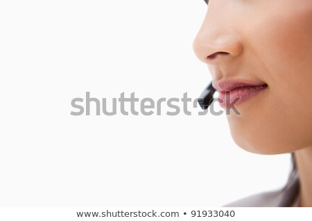 close up of smiling female call center agent against a white background stock photo © wavebreak_media