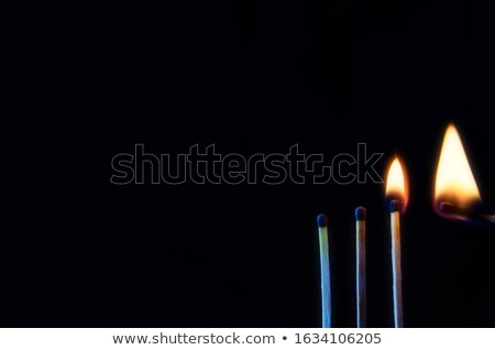 Horizontal match set on fire against a black background Stock photo © wavebreak_media